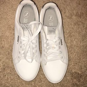 Brand new white Puma sneakers.